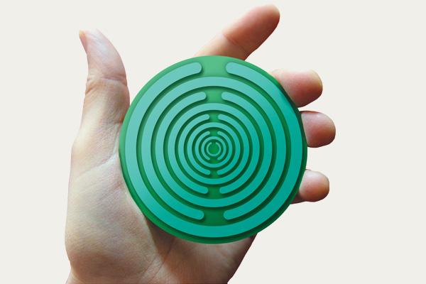 Hand holding a Polaraid disc